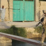 Crossing footbridge over a canal in Nawa, Afghanistan.