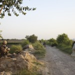 Guarding a footpath in Nawa, Afghanistan.